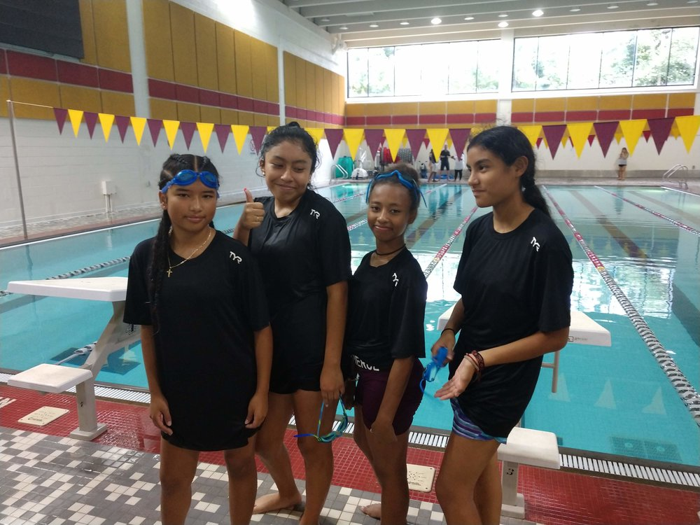Horizon students in front of a swimming pool.